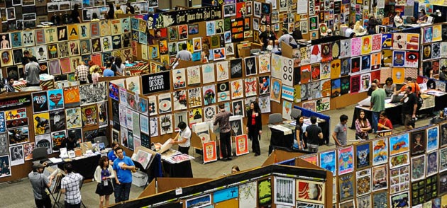 A photo of many posters covering temporary walls at the Flatstock poster convention from SXSW Flatstock 2011