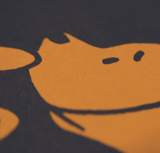close-up on navy-and-orange Pooh Bear